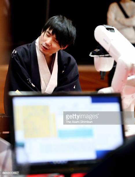 Professional Shogi player Amahiko Sato and shogi soft 'Ponanza' compete during the first round of the Deno Sen at Nikko Toshogu Shrine on April 1...