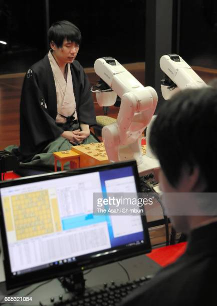 Professional Shogi player Amahiko Sato speaks during a press conference after his defeat by shogi soft 'Ponanza' in the first round of the Deno Sen...