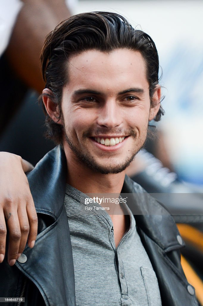Professional skateboarder Dylan Rieder poses for photos at a DKNY photo shoot in Times Square on October 14, 2013 in New York City.