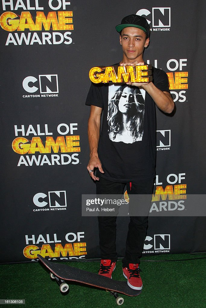Professional skateboarder Nyjah Huston poses in the press room during the 3rd Annual Cartoon Network's 'Hall Of Game' Awards held at Barker Hangar on February 9, 2013 in Santa Monica, California.