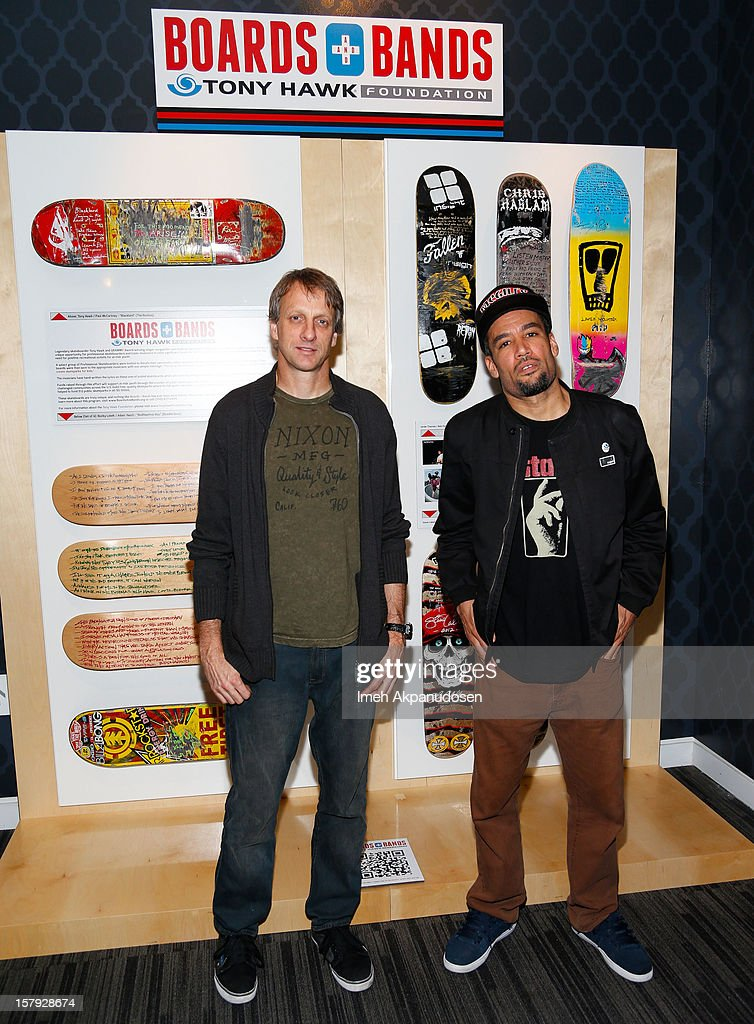 Professional skateboarder Tony Hawk and singer/songwriter Ben Harper attend a news conference for the Boards Bands project at The GRAMMY Museum on...