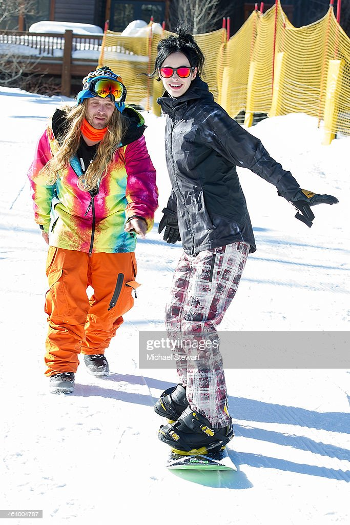 Professional snowboarder Dingo (L) and actress Krysten Ritter attend Oakley Learn To Ride With AOL At Sundance Day 3 on January 19, 2014 in Park City, Utah.