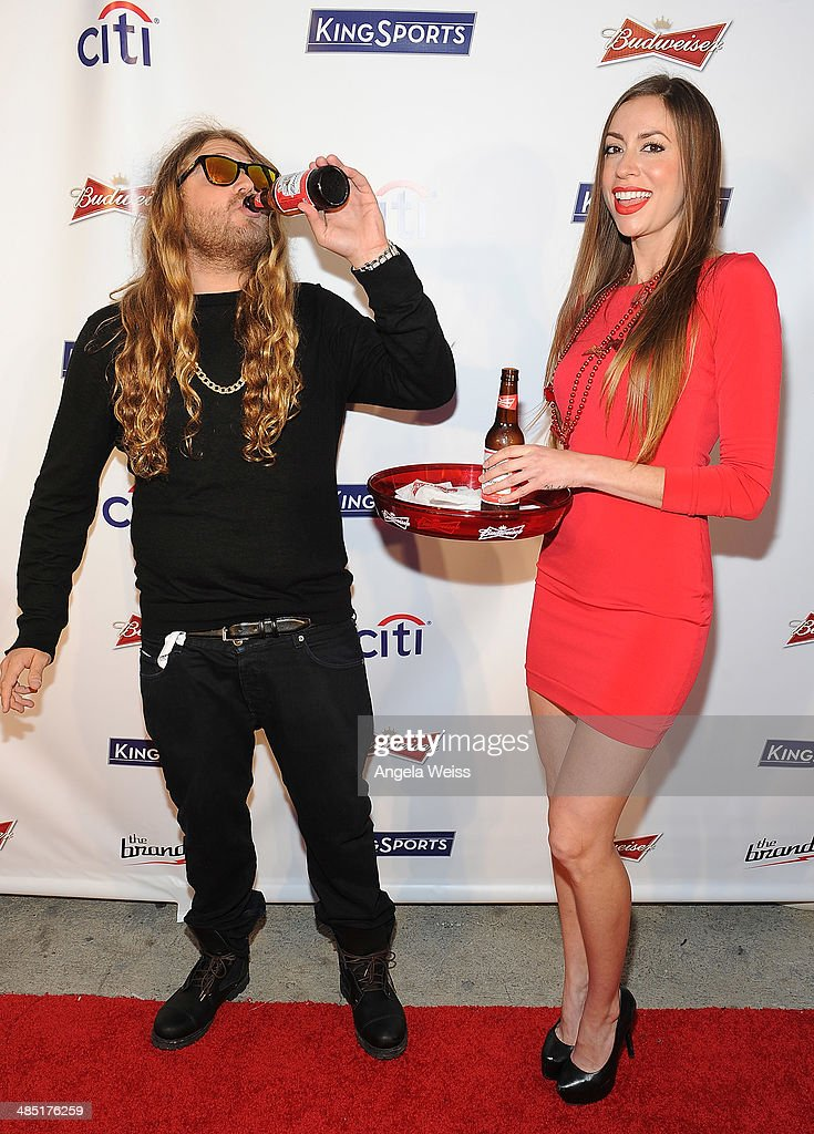 Professional snowboarder Dingo (L) attends Boxing at Barker presented by Budweiser at Barkar Hangar on April 16, 2014 in Santa Monica, California.