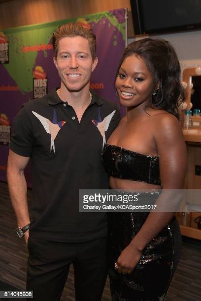 Professional snowboarder Shaun White and Olympic gymnast Gabby Douglas attend Nickelodeon Kids' Choice Sports Awards 2017 at Pauley Pavilion on July...
