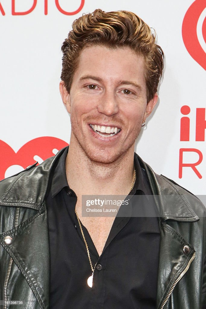 Professional snowboarder Shaun White poses in the iHeartRadio music festival photo room on September 20, 2013 in Las Vegas, Nevada.
