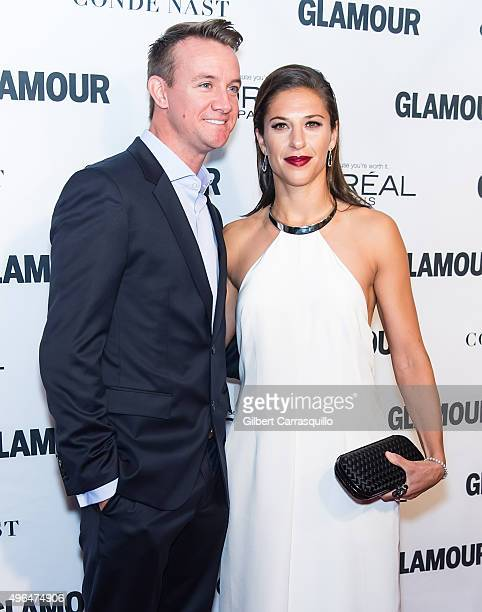 Professional soccer midfielder Carli Lloyd and fiance Brian Hollins attend Glamour's 25th Anniversary Women Of The Year Awards at Carnegie Hall on...
