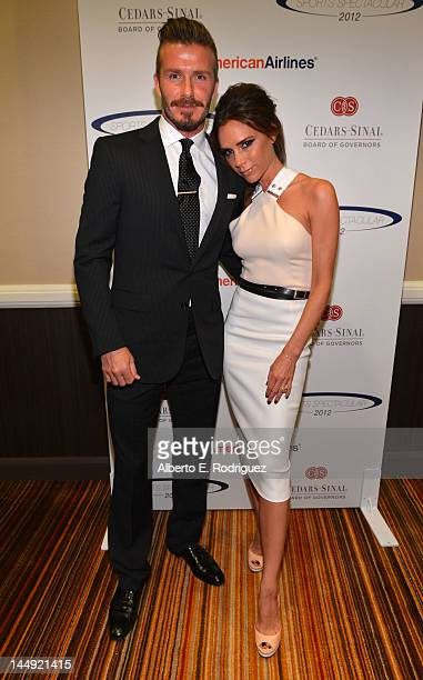 Professional soccer player David Beckham and wife Victoria Beckham arrive at the 27th Anniversary Sports Spectacular benefiting CedarsSinai Medical...
