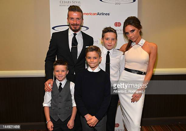 Professional soccer player David Beckham wife Victoria Beckham and sons Cruz Romeo and Brooklyn Beckham arrive at the 27th Anniversary Sports...