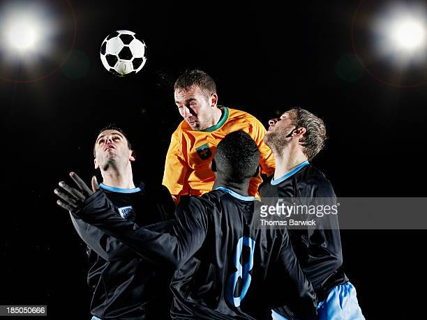 Professional soccer player heading ball
