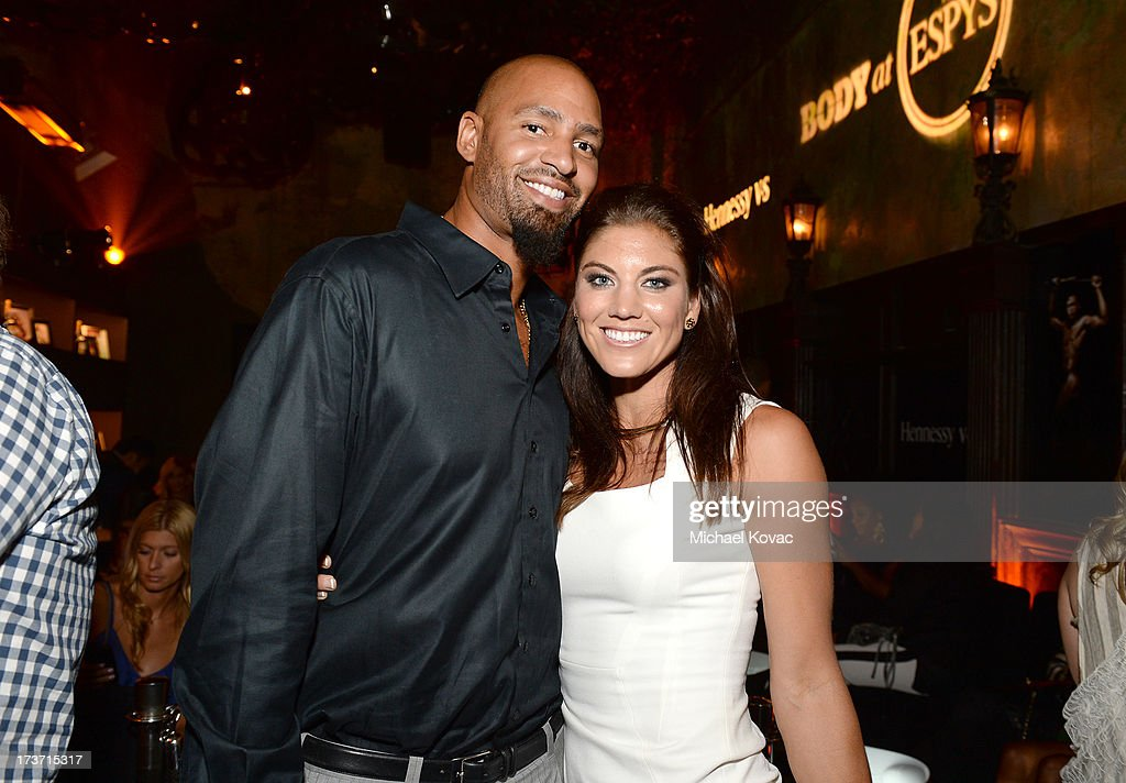 Professional soccer player Hope Solo (L) and Professional football player Jerramy Stevens attend ESPN the Magazine 5th annual 'Body Issue' party at Lure on July 16, 2013 in Hollywood, California.