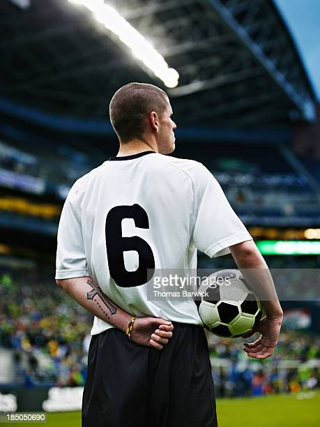 Professional soccer player standing in stadium