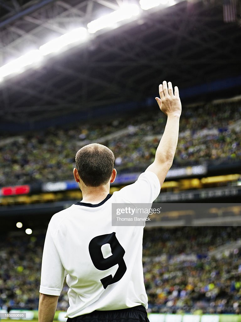 Professional soccer player waving to crowd : Stock Photo