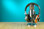 Professional studio microphone and headphones on wooden table 3d render