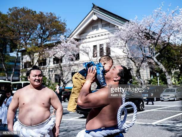 Professional Sumo wrestler Hakuho Sho Harumafuji Kohei and his kid are seen during the Ceremonial Sumo Tournament or Honozumo at the Yasukuni Shrine...