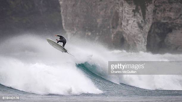 Professional surfer Al Mennie gets some air under the historic Dunluce Castle ruins on October 31 2016 in Portrush Northern Ireland Built in the...