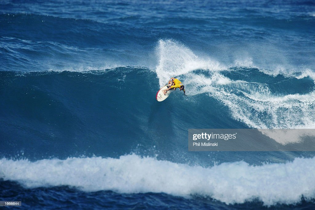 Professional surfer and reality TV show cast member Damien Hobgood catches a wave at the Rip Curl Cup surf contest December 2 2002 on Sunset Beach...