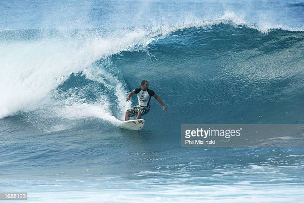 Professional surfer and reality TV show cast member Sunny Garcia pulls into the tube during the filming of WB network's reality TV show 'North Shore'...