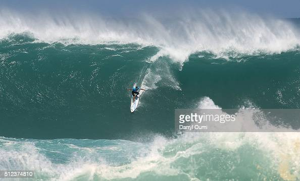 Professional surfer Jeremy Flores rides a wave during the first round of The Quiksilver in Memory of Eddie Aikau at Waimea Bay on February 25 2016 in...