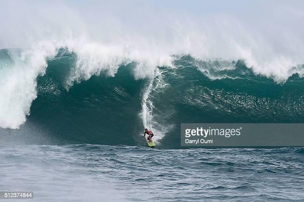 Professional surfer John John Florence makes the drop in a wave at Waimea Bay on February 25 2016 in Waimea Hawaii