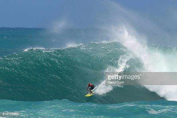 Professional surfer Kelly Slater rides a wave during the second round of The Quiksilver in Memory of Eddie Aikau at Waimea Bay on February 25 2016 in...