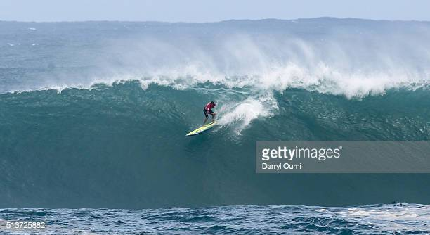 Professional surfer Nathan Fletcher rides a wave in the first round of The Quiksilver in Memory of Eddie Aikau at Waimea Bay on February 25 2016 in...