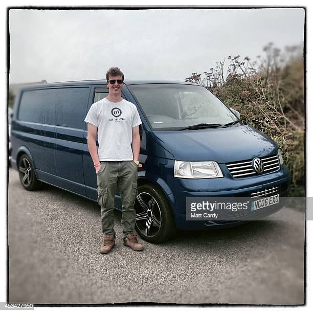 Professional surfer Zak Lawton from Croyde in Devon poses for a photograph besides his 2006 fifth generation T5 Volkswagen Transporter in Newquay on...