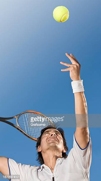 Professional tennis player hitting the ball