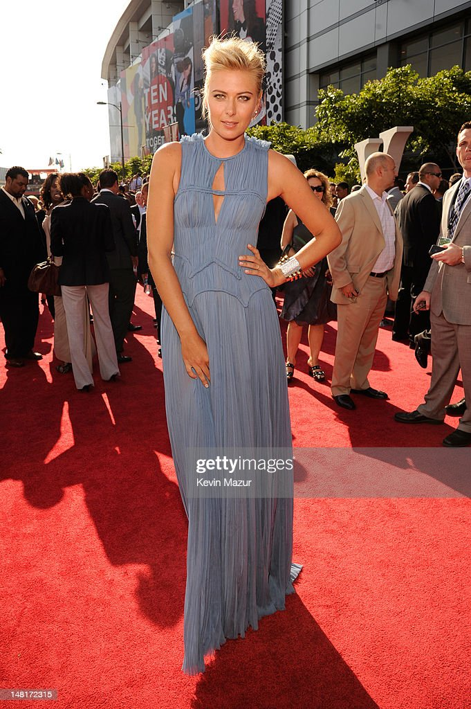 Professional tennis player <a gi-track='captionPersonalityLinkClicked' href=/galleries/search?phrase=Maria+Sharapova&family=editorial&specificpeople=157600 ng-click='$event.stopPropagation()'>Maria Sharapova</a> arrives at the 2012 ESPY Awards at Nokia Theatre L.A. Live on July 11, 2012 in Los Angeles, California.
