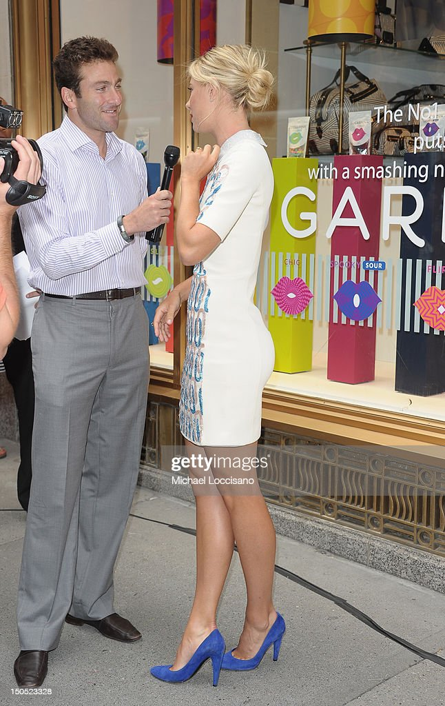 Professional Tennis Player <a gi-track='captionPersonalityLinkClicked' href=/galleries/search?phrase=Maria+Sharapova&family=editorial&specificpeople=157600 ng-click='$event.stopPropagation()'>Maria Sharapova</a> is interviewed during her Sugarpova candy launch at Henri Bendel on August 20, 2012 in New York City.