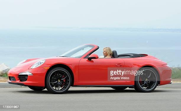 Professional tennis player Maria Sharapova poses during a Porsche shooting on July 11 2013 in Manhattan Beach California