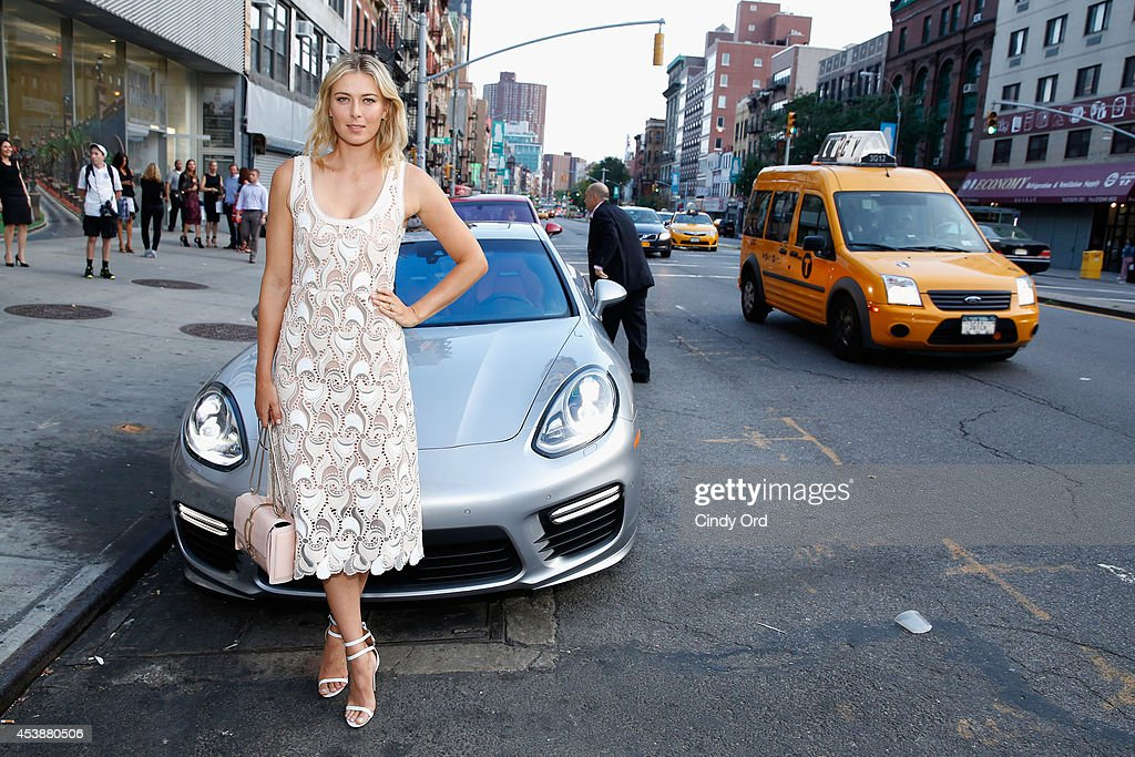 Professional tennis player <a gi-track='captionPersonalityLinkClicked' href=/galleries/search?phrase=Maria+Sharapova&family=editorial&specificpeople=157600 ng-click='$event.stopPropagation()'>Maria Sharapova</a> poses with a Porsche Panamera Turbo at the CFDA Celebrates Fashion Targets Breast Cancer 20th Anniversary event with <a gi-track='captionPersonalityLinkClicked' href=/galleries/search?phrase=Maria+Sharapova&family=editorial&specificpeople=157600 ng-click='$event.stopPropagation()'>Maria Sharapova</a>, presented by Porsche at The New Museum on August 20, 2014 in New York City.