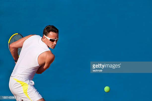 Professional tennis player on the blue background
