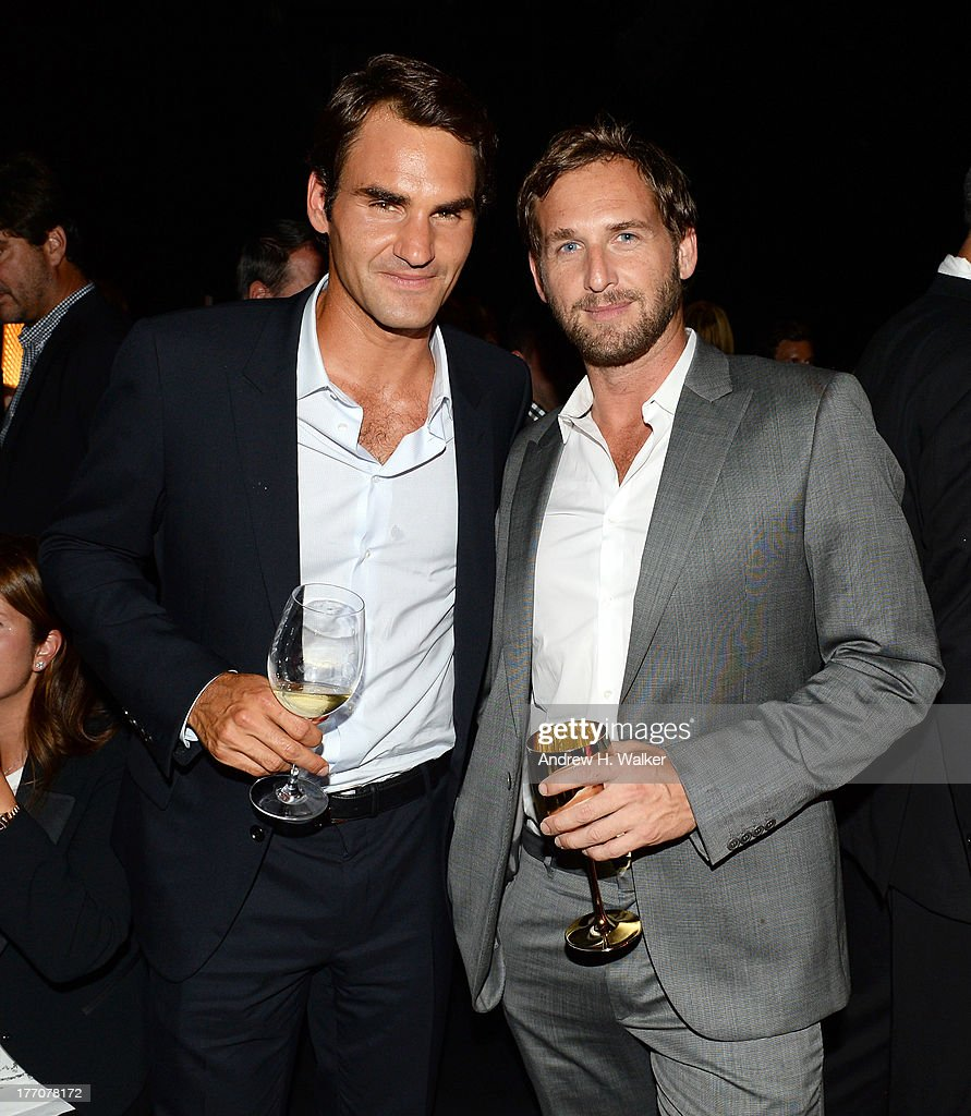 Professional Tennis Player Roger Federer (L) and Actor Josh Lucas attend Moet & Chandon Celebrates Its 270th Anniversary With New Global Brand Ambassador, International Tennis Champion, Roger Federer at Chelsea Piers Sports Center on August 20, 2013 in New York City.