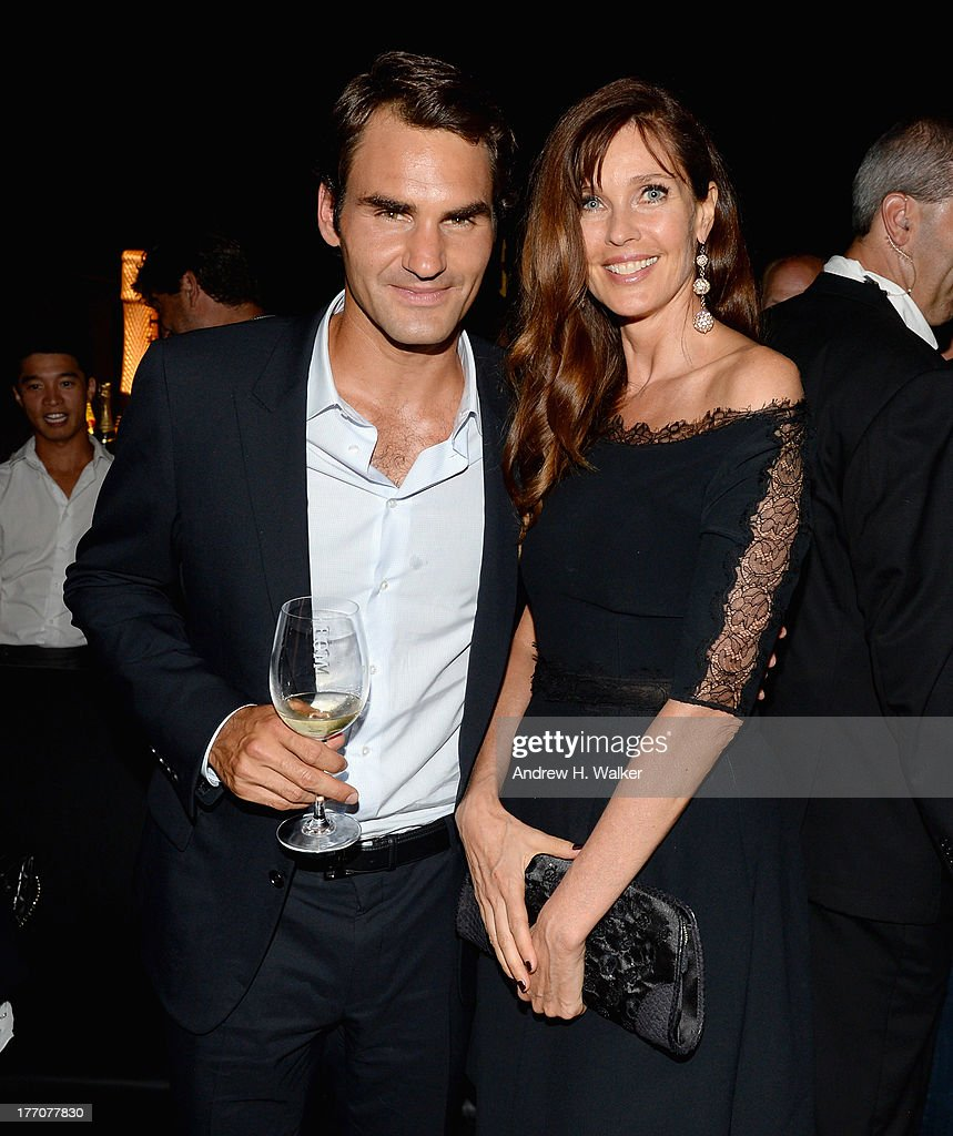 Professional Tennis Player Roger Federer and model Carol Alt attend Moet & Chandon Celebrates Its 270th Anniversary With New Global Brand Ambassador, International Tennis Champion, Roger Federer at Chelsea Piers Sports Center on August 20, 2013 in New York City.