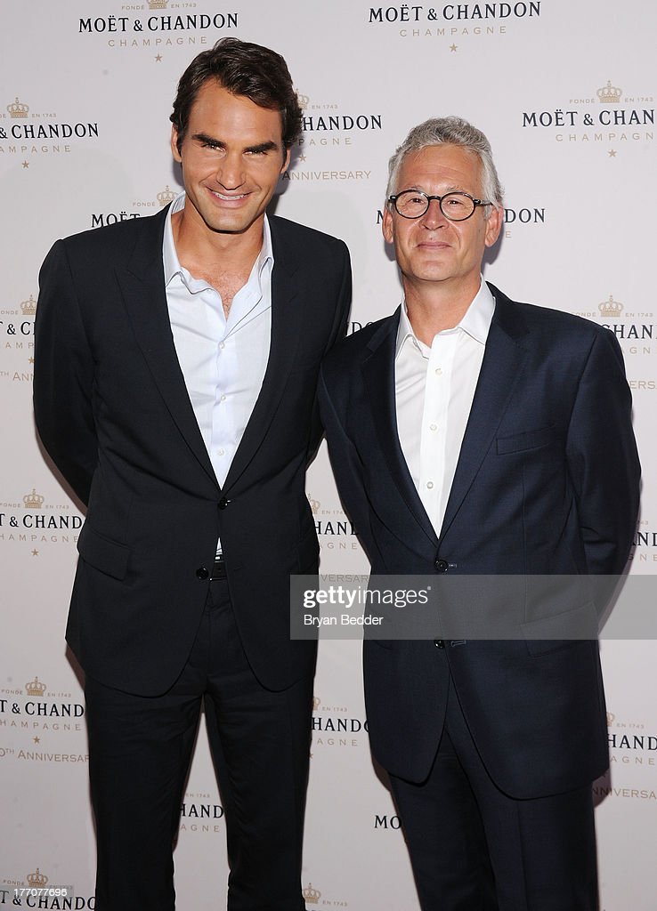 Professional tennis player <a gi-track='captionPersonalityLinkClicked' href=/galleries/search?phrase=Roger+Federer&family=editorial&specificpeople=157480 ng-click='$event.stopPropagation()'>Roger Federer</a> (L) and Moet & Chandon CEO Stephane Baschiera attend Moet & Chandon Celebrates Its 270th Anniversary With New Global Brand Ambassador, International Tennis Champion, <a gi-track='captionPersonalityLinkClicked' href=/galleries/search?phrase=Roger+Federer&family=editorial&specificpeople=157480 ng-click='$event.stopPropagation()'>Roger Federer</a> at Chelsea Piers Sports Center on August 20, 2013 in New York City.