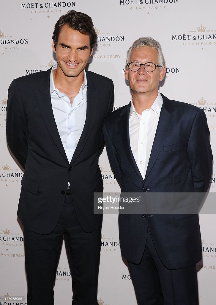 Professional Tennis Player Roger Federer (L) and Moet & Chandon CEO Stephane Baschiera attend Moet & Chandon Celebrates Its 270th Anniversary With New Global Brand Ambassador, International Tennis Champion, Roger Federer at Chelsea Piers Sports Center on August 20, 2013 in New York City.