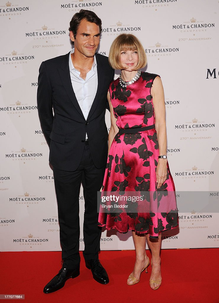 Professional Tennis Player Roger Federer (L) and Vogue Editor-in-Chief Anna Wintour attend Moet & Chandon Celebrates Its 270th Anniversary With New Global Brand Ambassador, International Tennis Champion, Roger Federer at Chelsea Piers Sports Center on August 20, 2013 in New York City.