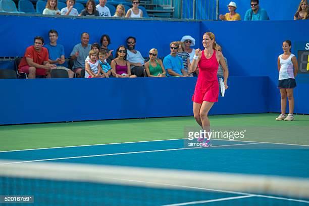 Professional Tennis Player Winning The Match