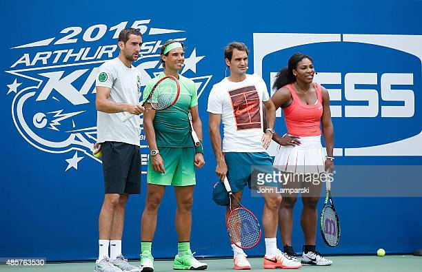 Professional tennis players Marin Cilic Rafael Nadal Roger Federer and Serena Williams participate during the 20th Annual Arthur Ashe Kids' Day at...