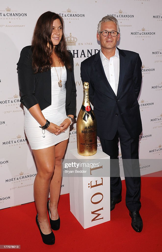 Professional Tennis Players Marion Bartoli and Moet & Chandon CEO Stephane Baschiera attend Moet & Chandon Celebrates Its 270th Anniversary With New Global Brand Ambassador, International Tennis Champion, Roger Federer at Chelsea Piers Sports Center on August 20, 2013 in New York City.
