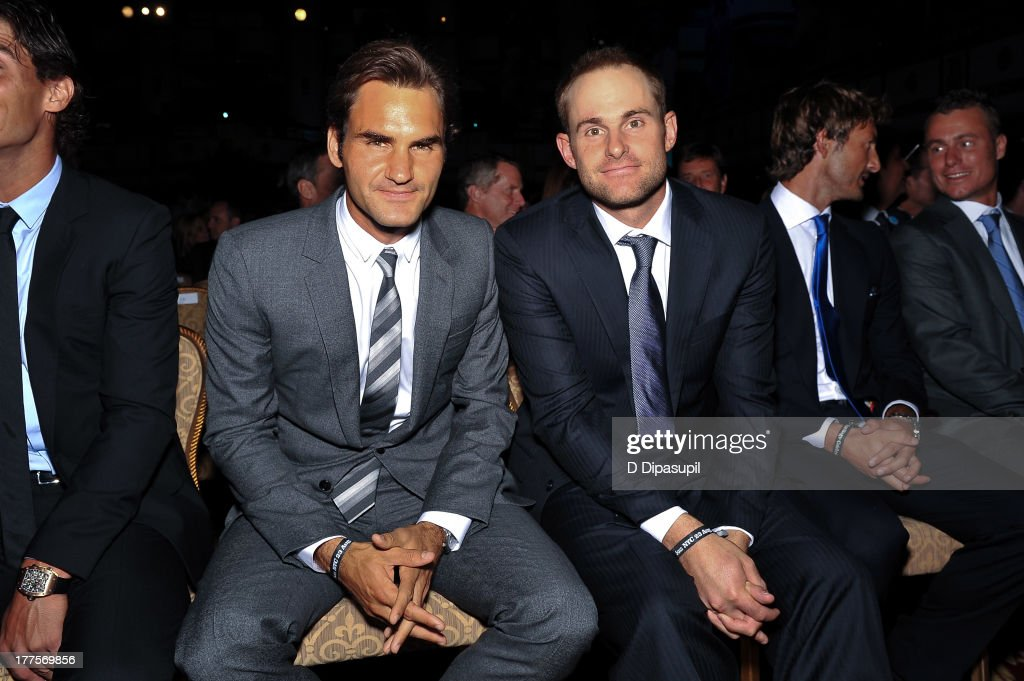 Professional tennis players Roger Federer (L) and Andy Roddick attend the ATP Heritage Celebration at The Waldorf=Astoria on August 23, 2013 in New York City.