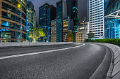 clean road with modern  illuminated buildings background,Hong Kong,china,asia.