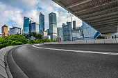 empty asphalt road with central district of Hong Kong on background,China.