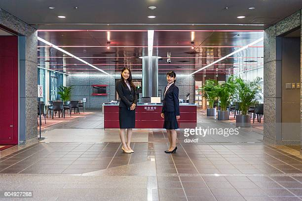 Professional Welcome at Business Reception by Women in Office Building