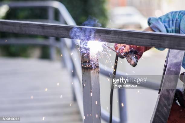 Professional welder, welding steel bars