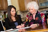 A business woman working with her senior citizen client.