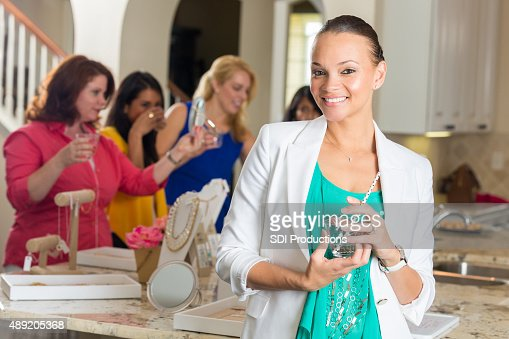 Professional woman attending direct sales home jewelry party