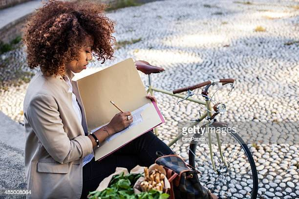 Professional woman filling papers during lunch break