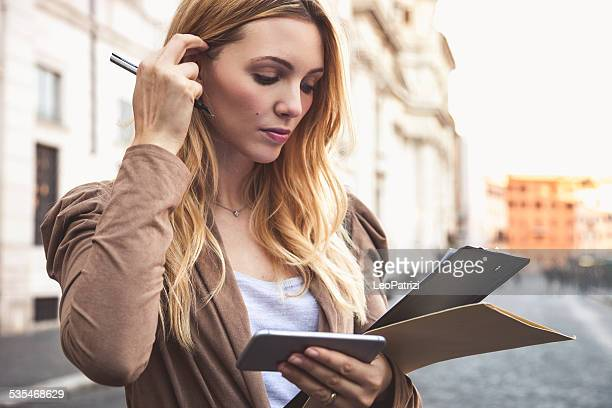 Professional woman holding file folder and contracts