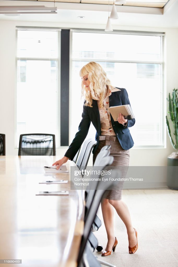 Professional woman putting out supplies on a table